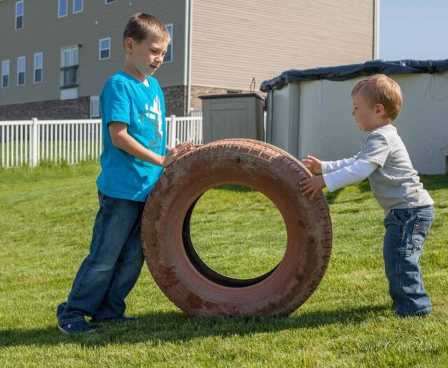 Pushing and pulling heavy objects like a tire can be a powerful sensory diet activity