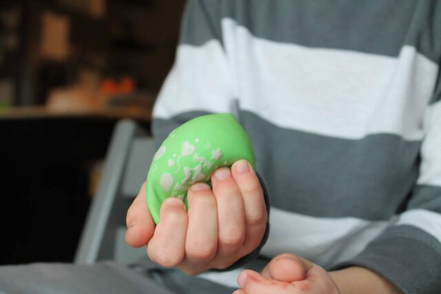 Squeezing a stress ball can be very calming and reduce anxiety for kids. A great activity to include in a sensory diet.